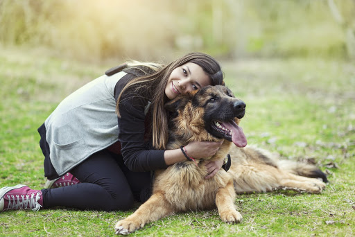 A happy woman hugging her new rescue dog